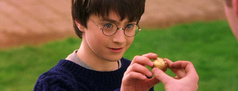 Harry holding the snitch for the first time
